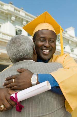 alumnae: Graduate Hugging Father LANG_EVOIMAGES
