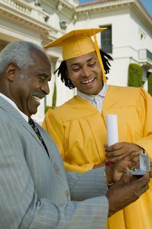 twentysomething: Father Giving Son Graduation Gift LANG_EVOIMAGES