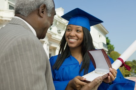 alumnae: Father Giving Daughter Graduation Gift
