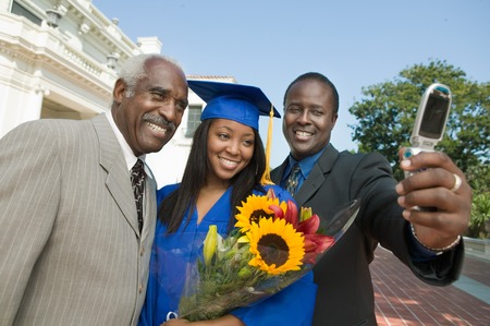 Graduate Taking Pictures with Father and Grandfather Stock Photo - 5428465