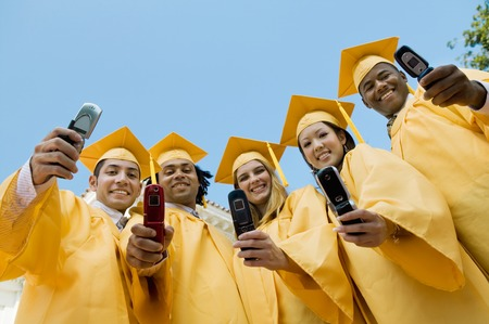 twentysomething: Graduates Taking Pictures with Camera Phones LANG_EVOIMAGES