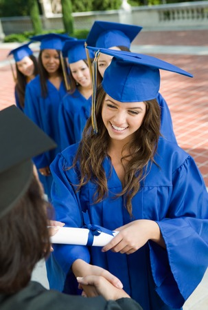 Graduate Shaking Hands and Receiving Diploma Stock Photo - 5428470