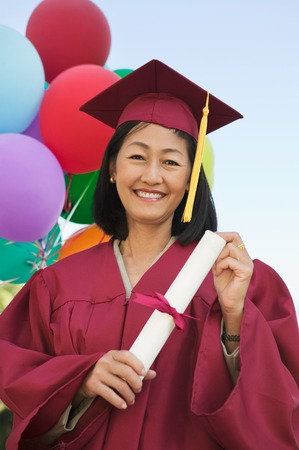 academic robe: Graduate Holding Diploma LANG_EVOIMAGES