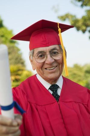 Senior Graduate with Diploma Stock Photo - 5428474