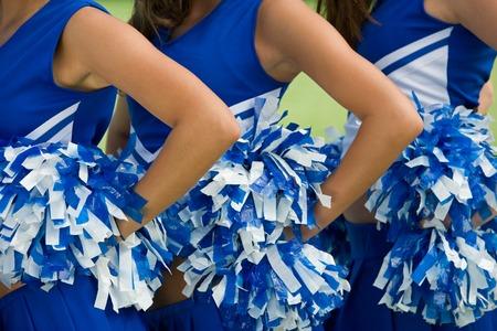 Cheerleaders in Uniform Holding Pom-Poms Stock Photo - 5428496