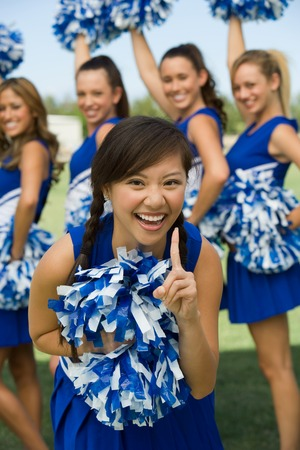cheerleading squad: Cheerleader Showing Squad is Number One