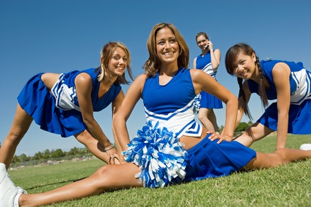 early teens: Cheerleaders Stretching During Practice