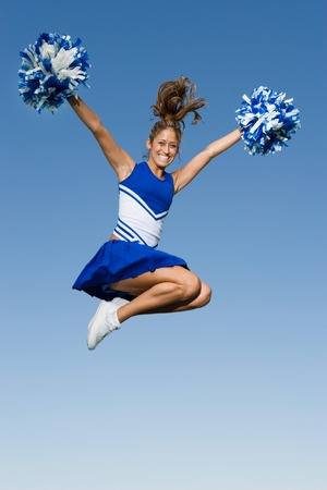 Cheerleader Jumping in Mid-Air Stock Photo - 5428504