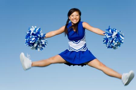 Cheerleader Performing Cheer in Mid-Air