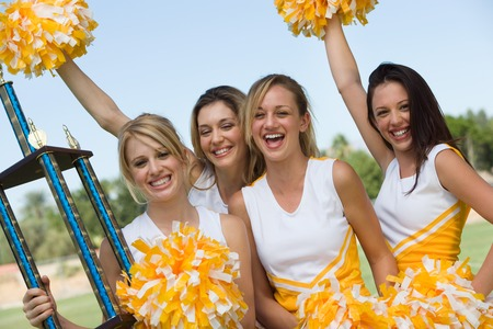 cheerleading squad: Cheerleaders Celebrating Victory LANG_EVOIMAGES