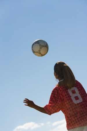 Teenage Girl Heading Soccer Ball Stock Photo - 5435738