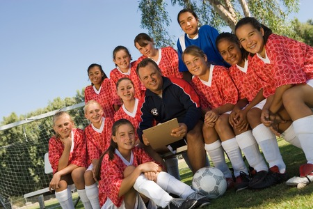 Coach with Girls Soccer Team Stock Photo - 5435740