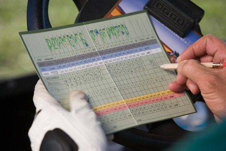 scoring: Golfer Marking Score on Scorecard LANG_EVOIMAGES