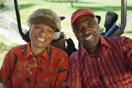 seres vivos: Los golfistas Sentado en el carrito