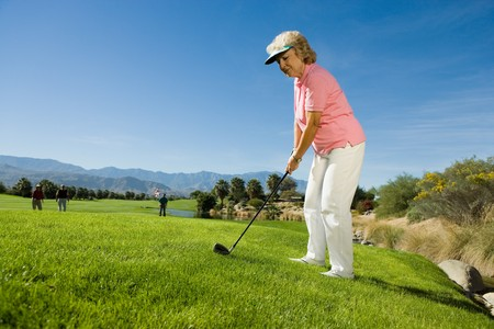 beforehand: Golfer Planning Shot While Others Wait
