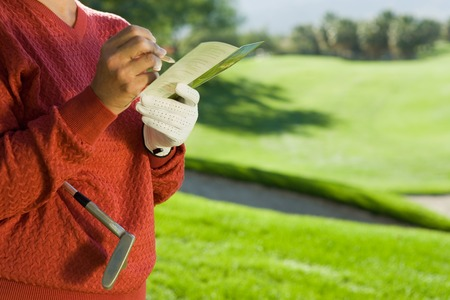 Golfer Writing in Scorecard Stock Photo