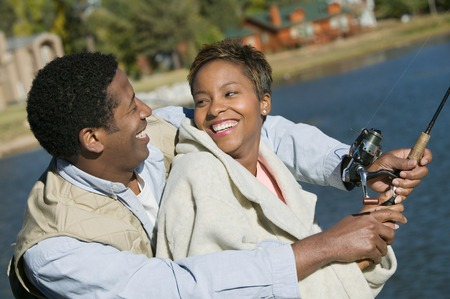 Smiling Couple Fishing Together Stock Photo - 5435797