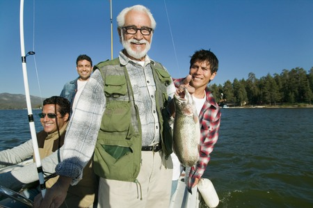 Father and Sons on Fishing Boat with Nice Fish Stock Photo - 5435798