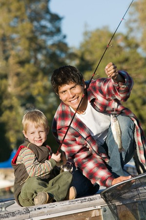 late thirties: Father and Son Catching Fish