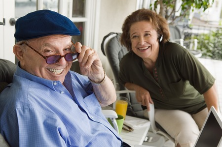 70s adult: Senior Couple with Laptop