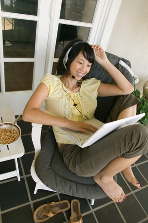 handsfree phone: Woman Relaxing on Porch