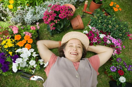 lay down: Senior Woman Relaxing in Garden