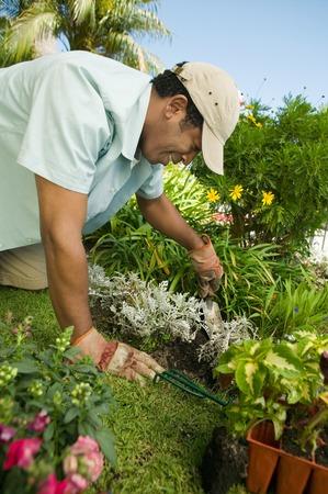 exerting: Man Gardening LANG_EVOIMAGES