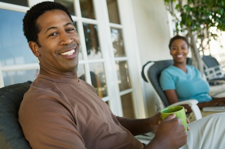 early 30s: Couple Relaxing on Porch