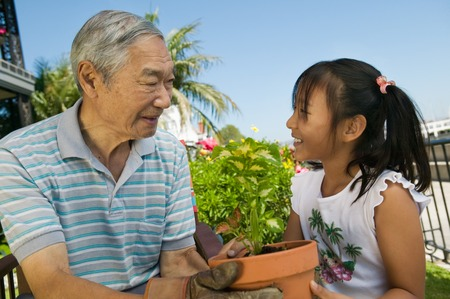 domesticity: Grandfather and Granddaughter Gardening
