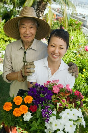 early 30s: Man and Woman Gardening