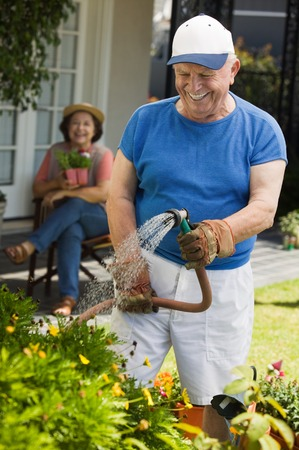 Senior Man Watering the Garden Stock Photo - 5435854