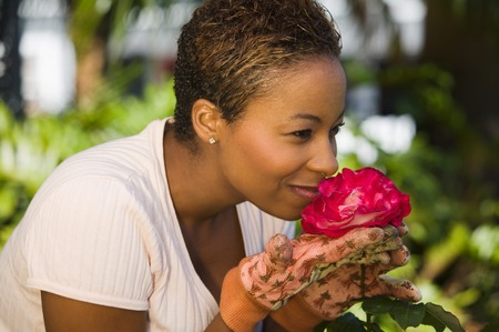 Gardener Smelling a Rose Stock Photo - 5435861