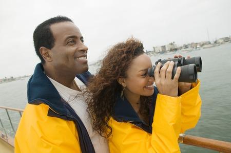 Couple on Boat with Binoculars Stock Photo - 5435881
