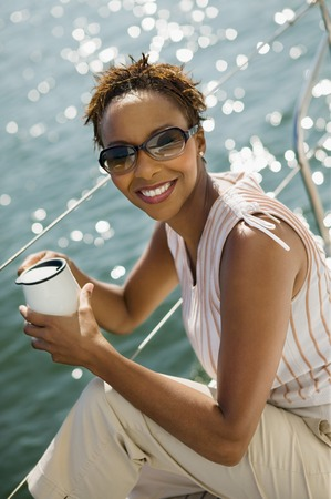Woman Drinking Coffee on Boat Stock Photo - 5435885