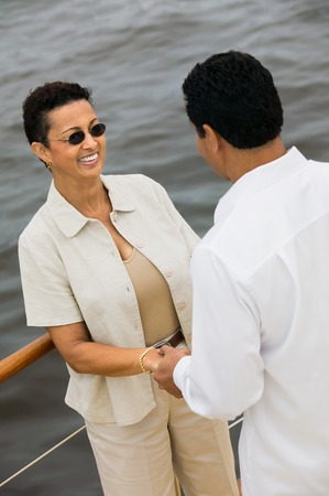 late forties: Couple Holding Hands on Boat
