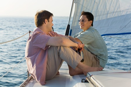 Friends Sitting on Sailboat Stock Photo - 5435898