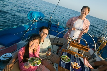 Friends Eating Salad on Sailboat Stock Photo - 5435900