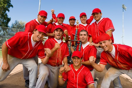 recreational sports: Teammates Holding Trophy LANG_EVOIMAGES