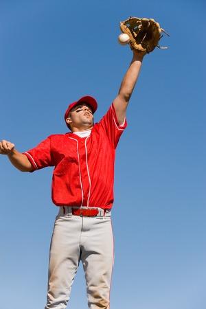 exerting: Outfielder Catching Baseball