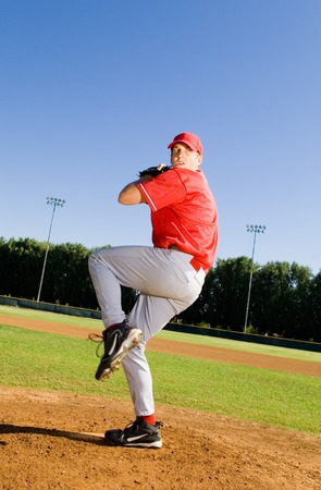 baseball game: Baseball Pitcher Throwing a Pitch LANG_EVOIMAGES