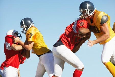 aggressively: Football Players Tackling