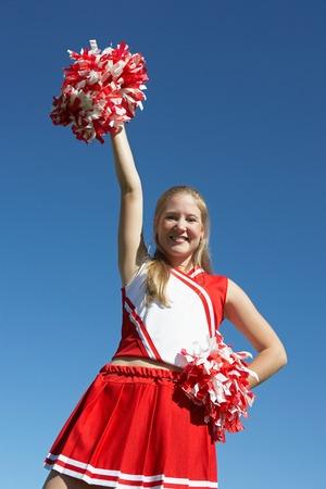 exuberance: Cheerleader with Pom-poms