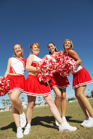 low spirited: Cheerleaders with Pom-poms