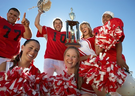 arms lifted up: Cheerleaders and Football Players Celebrating LANG_EVOIMAGES
