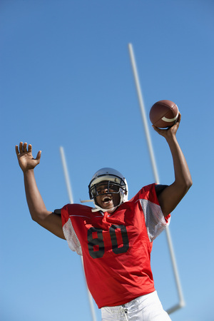 arms lifted up: Football Player Celebrating Touchdown
