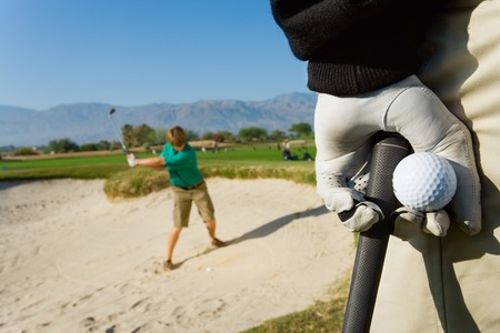 Young Man Hitting Ball in Sand Trap Stock Photo - 5435964
