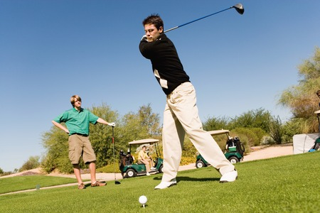 Golfer Teeing Off While Friend Watches Stock Photo - 5435968