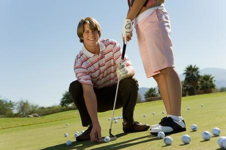 instructions: Golf Istruttore con studenti