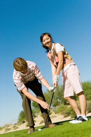 Woman Learning to Play Golf Stock Photo