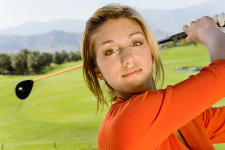 twentysomething: Golfer Standing on Fairway LANG_EVOIMAGES